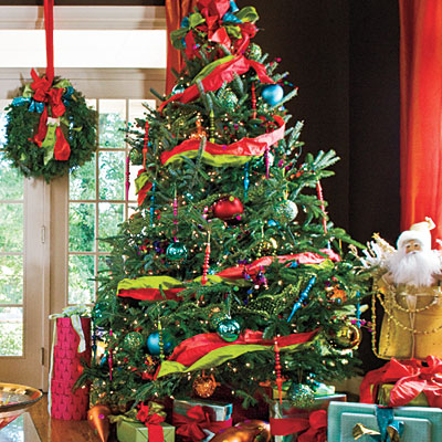 glass balls lights matching ornaments sweets and much more and more decorative pieces have filled the tree making the christmas spirit more colorful - Glass Christmas Tree With Lights