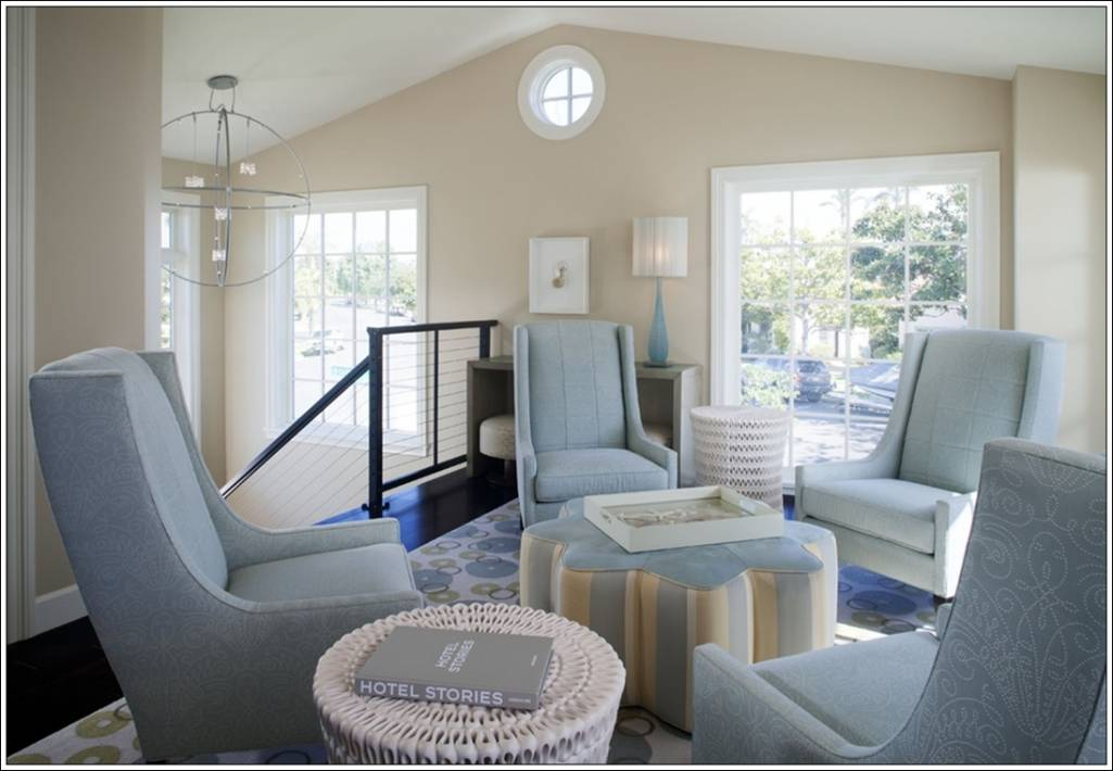 This living room which is just near the stairs is just classy. It has four comfortable seats of blue colour and a star shaped centre table with ... & Create Magic with Four Chairs in Living Room !