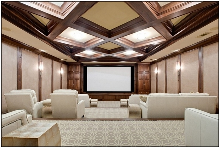 this home theatre is giving a sense of freedom with its spacious design and a ceiling that has wooden work and lighting contrasting so well with the white - Home Theater Design