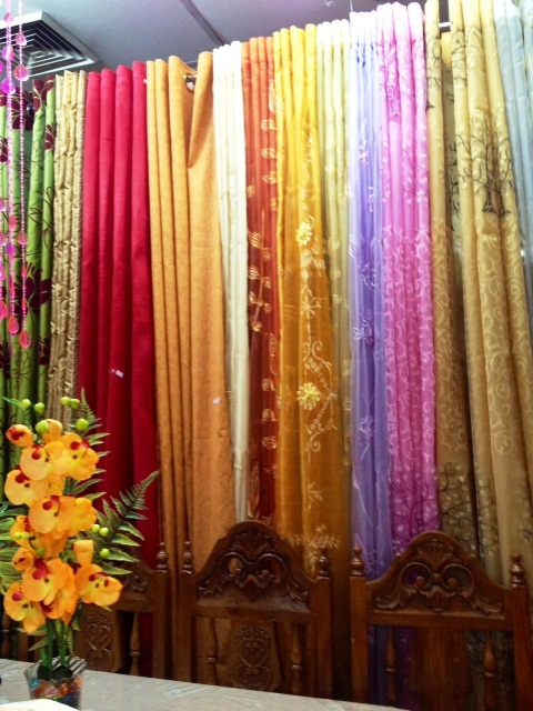 Multi Color Curtains Of Different Textures And Fabrics Provide An  Attractive Contrast