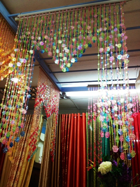 Crystal bead curtins gives a dreamy appeal to the bedroom