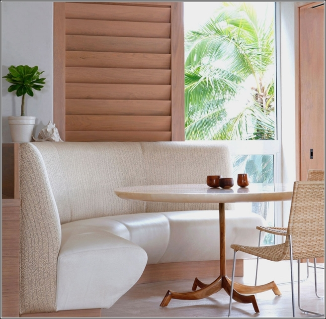 This Nook With A Chic And Modern Look Is Done In White Coloured Curved Sofa  With Wooden Walls. Rattan Chairs And Wooden Table Are Also The Perfect  Addition ...