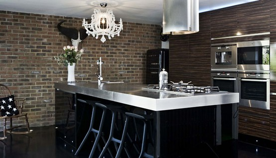 Contemporary kitchen with dark  brick wall