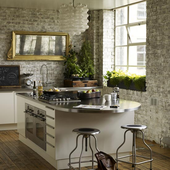 Elegant Kitchen with brick wall