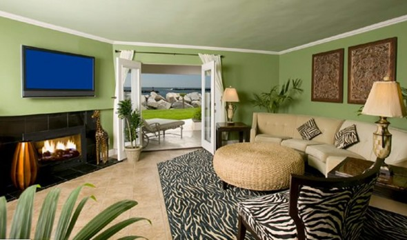 Cheerful background color, animal print furniture and a fireplace that ...