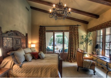 Classy Bedroom with Bold Exposed Roof Beams
