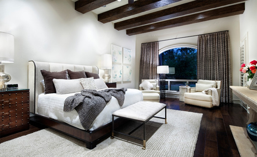 Contemporary Bedrroom with exposed roof beams
