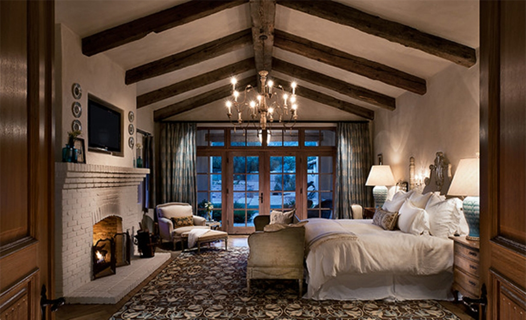 Country Side Bedroom with Exposed Roof beams on Chatedral Ceiling
