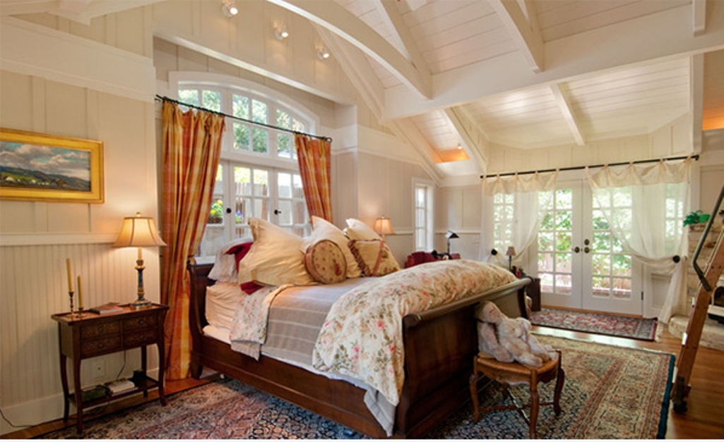 Cozy Bedroom With Exposed Roof Beams
