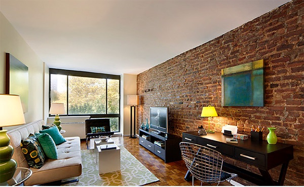 Sophsiticated Living Room with Brick wall design
