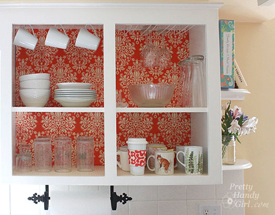 Cabinet with fabric backing via Brittany Bailey