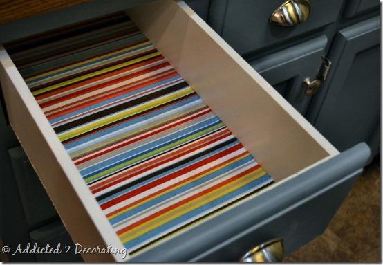 Drawer with stripped fabric via Kristi Linauer