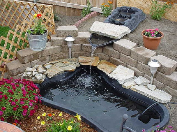 How outdoor pond ideas can really beautify your garden for Cheap pond ideas