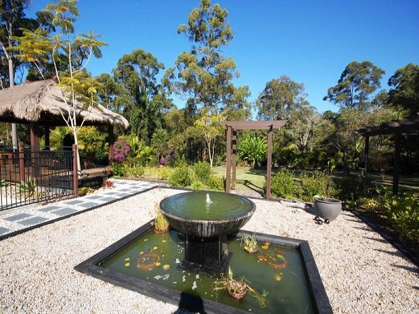 How outdoor pond ideas can really beautify your garden for Pond shade ideas
