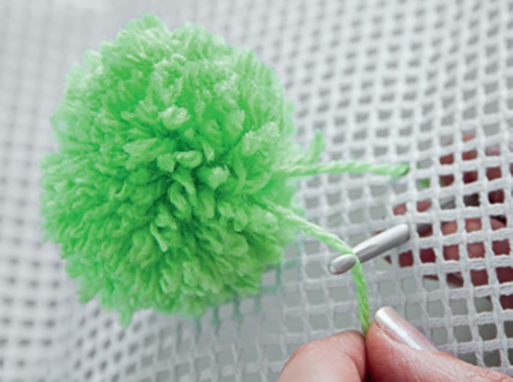 3.Attach the pompom by sewing to the net