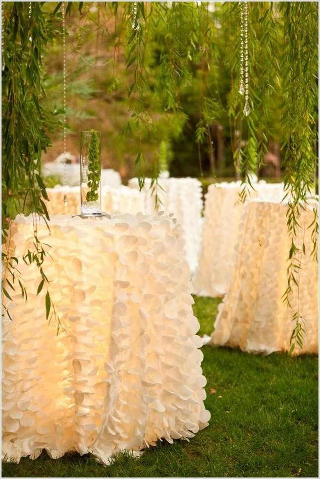 3 white ruffled skirts for wedding tables