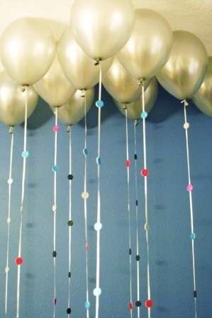 Attach sparkly foam circles to balloon strings.