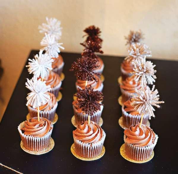 metallic yarn pom-poms as cupcake toppers.