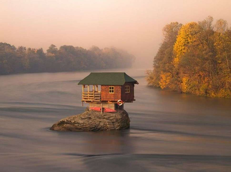 Tiny house sitting on a rock