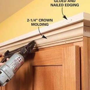 Add molding + shelving to the top of your kitchen cabinets.