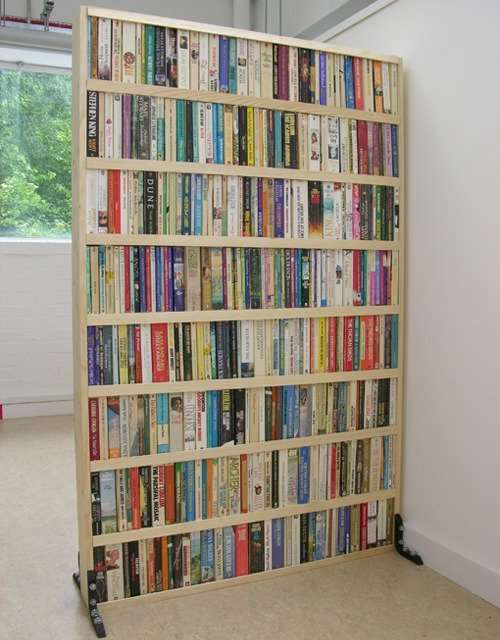 Divide the room in style with a book partition