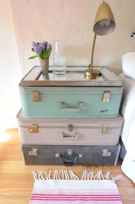 bedside table from vintage suitcases and an old mirro