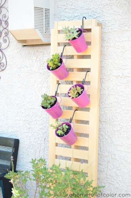bucket planters on the wall