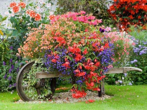 wooden wheelbarrow with flowers.