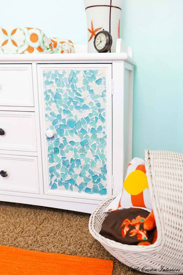 .A Dresser decorated with sea glass