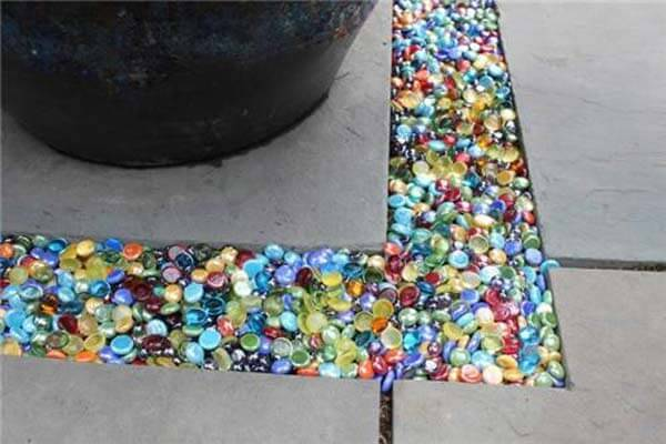 Colored Gl Being Used To Fill The Gap Between Paving Stones