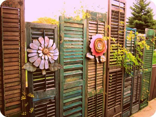 Fence made of assortd old shutters
