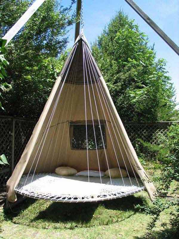 a tree-house, a hammock, a tire swing and a trampoline,