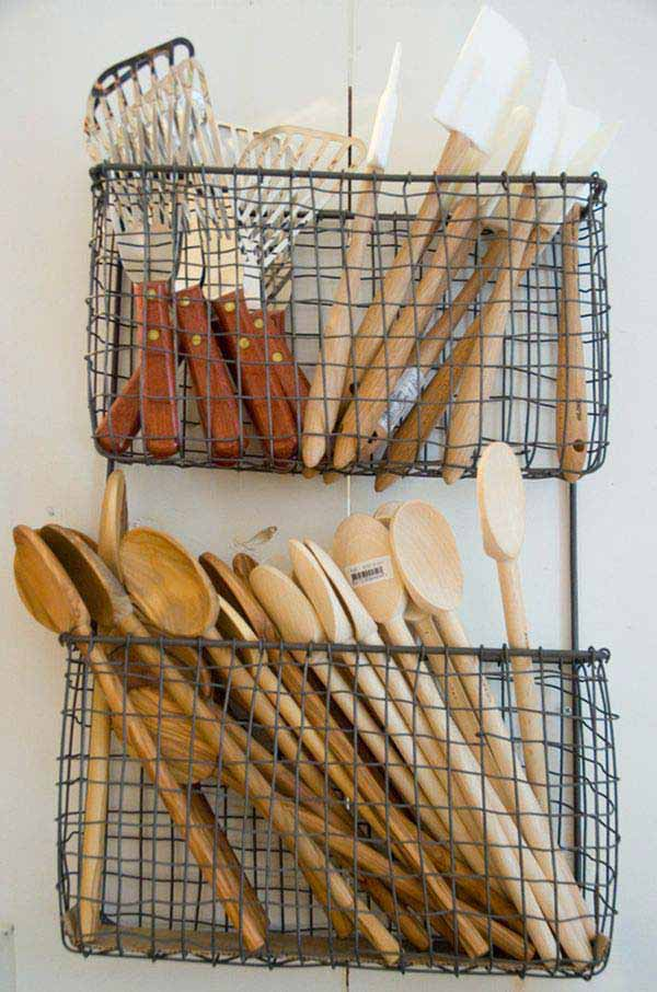 wooden spoons and kitchen utensils in baskets