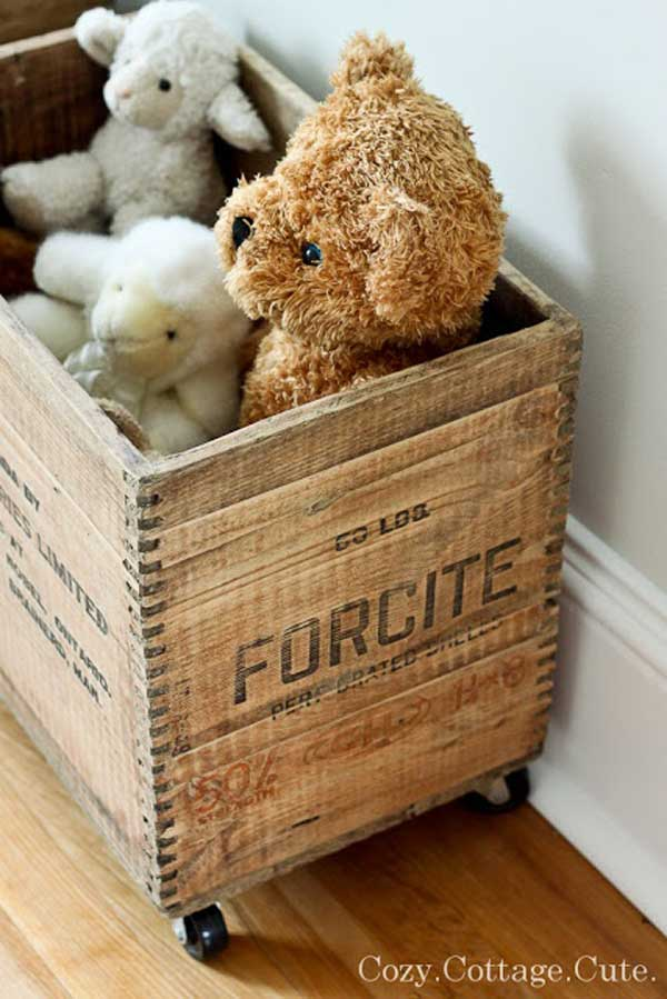 Rustic wooden crate on wheels for toy Storage