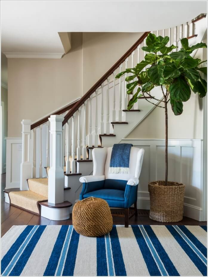 10 chic seating options for creating a welcoming entryway for Furniture for curved wall in foyer