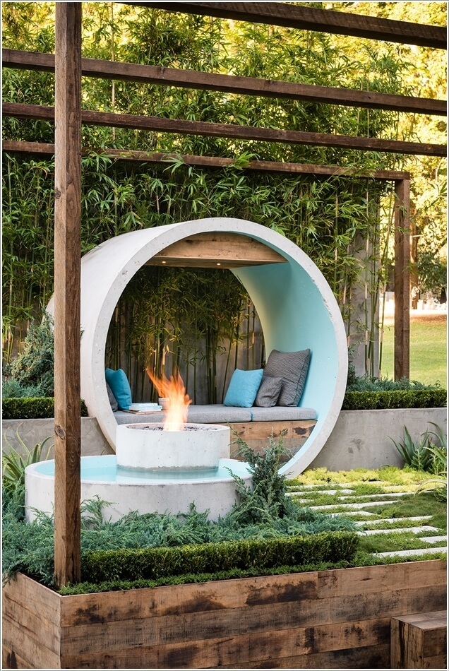 A Water Feature And Fire Pit Combo Created From Concrete Pipes