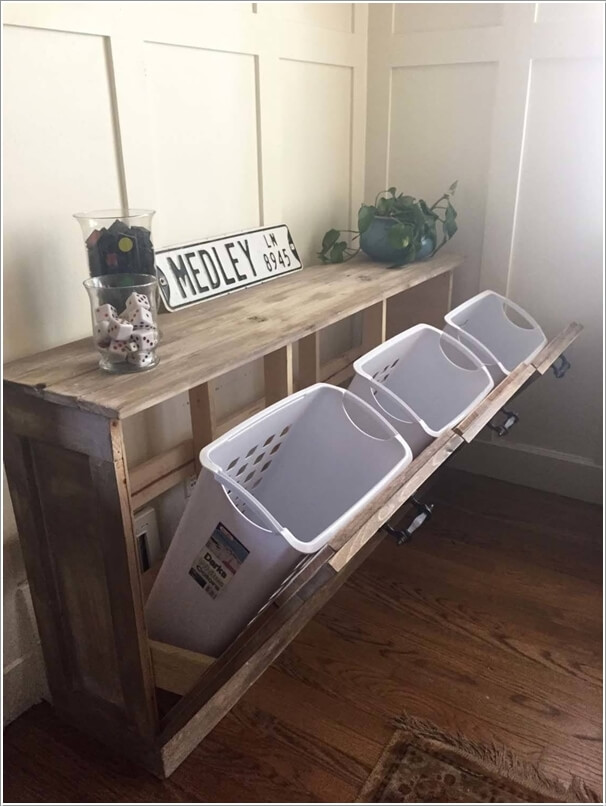 1. Make A Sorter For Your Landry Room With A Pallet Frame And Plastic Bins