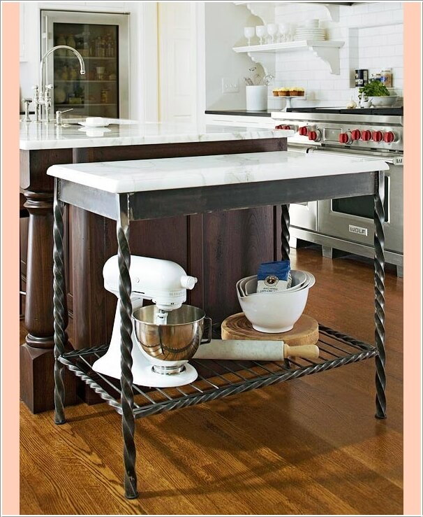 Place A Marble Top Table Along The Kitchen Island For Baking Preparation