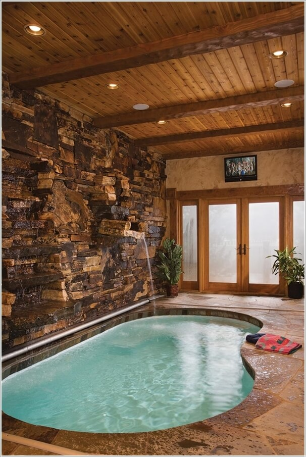Indoor Pool Ideas Part - 45: A Beauteous Swimming Pool With A Water Fall Stone Wall