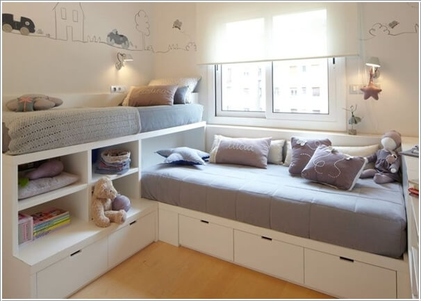 A Bunk Bed in L Shape with Open Shelves and Bottom Storage Drawers