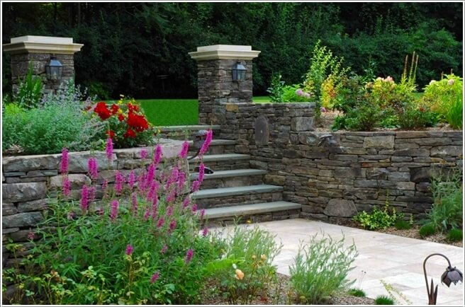 A Charming Stacked Stone Wall Built Around A Garden