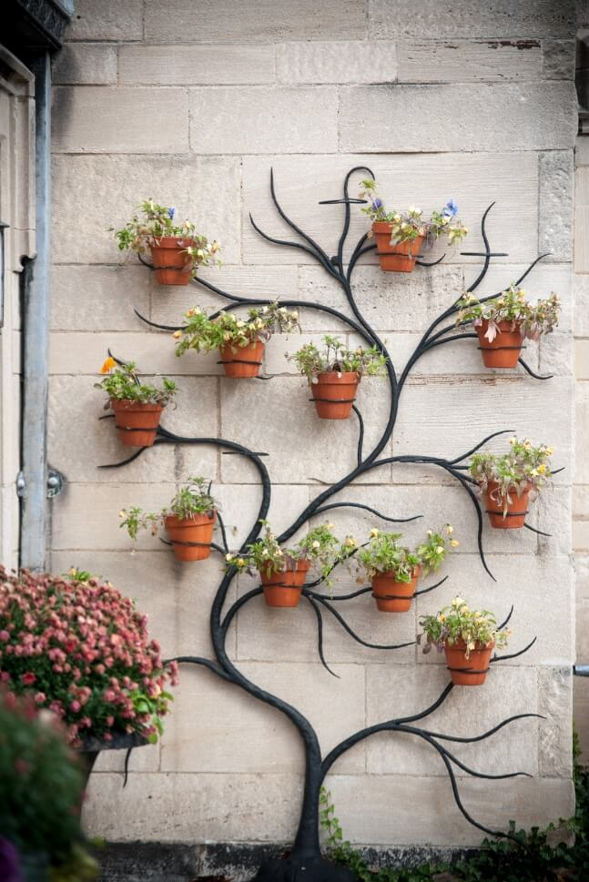 Ideas to Display Planters on an Outdoor Wall on Garden Patio Wall Ideas id=90228
